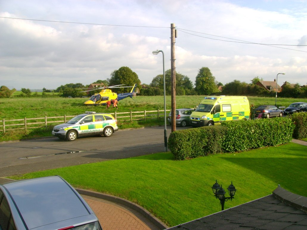 Air Ambulance uses field as landing site to pick up a patient from the land Ambulance